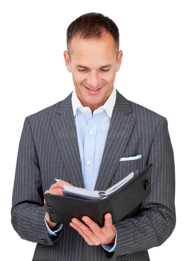 Attractive businessman consulting his agenda