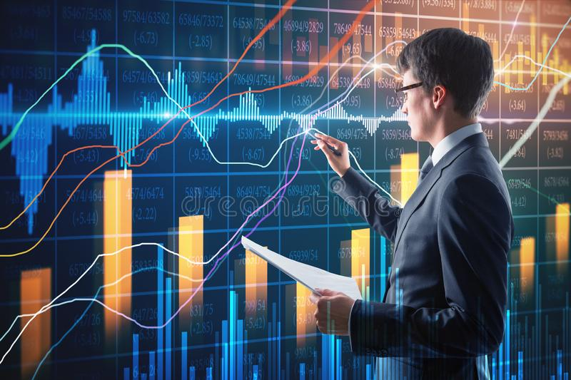 Attractive businessman with forex chart royalty free stock image