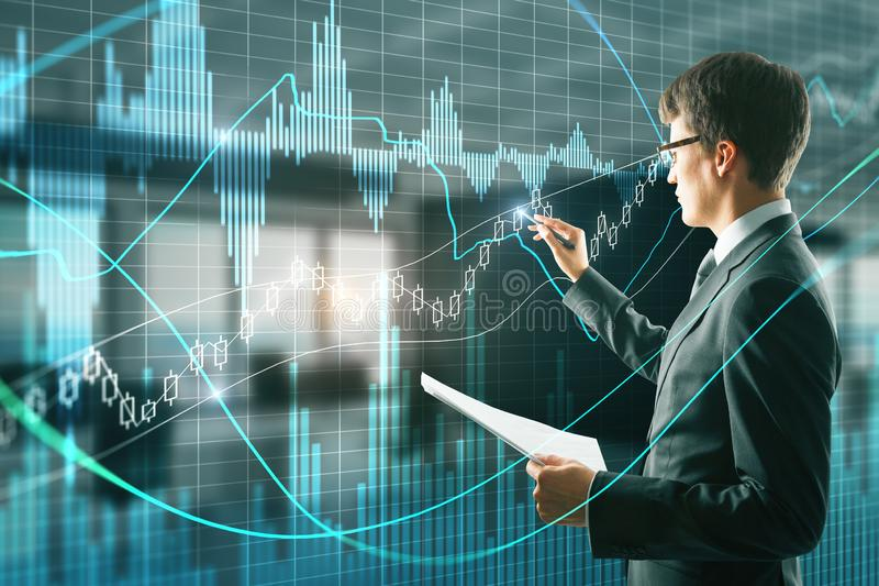 Attractive businessman with forex chart royalty free stock photos