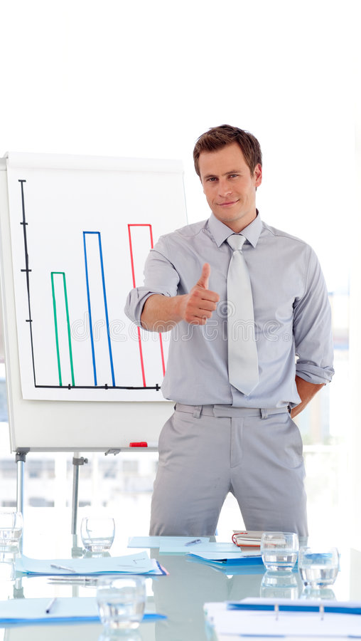 Attractive Businessman Giving Presentation Royalty Free Stock Images