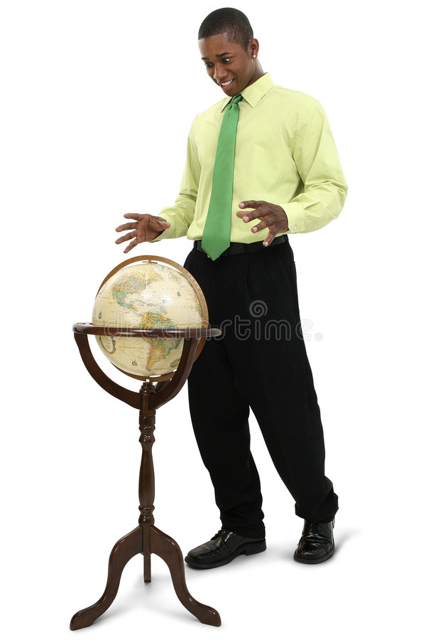 Attractive Businessman Reaching for Globe stock photo