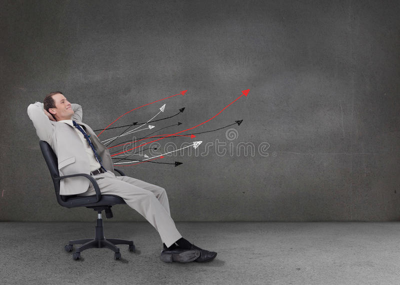 Attractive businessman relaxing on his chair stock photography