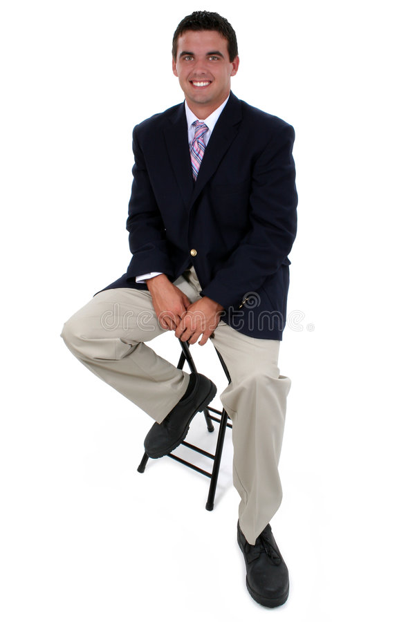 Attractive Businessman Sitting On Stool. Shot in studio over white with the Canon 20D royalty free stock images
