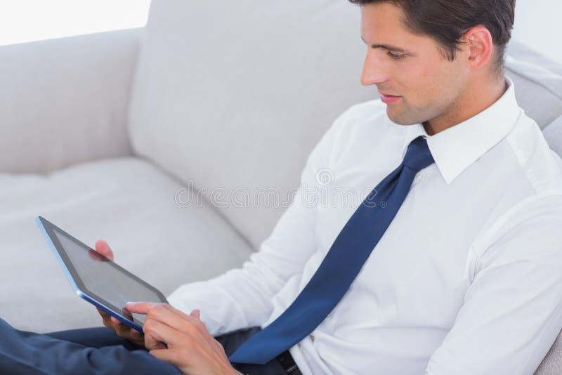 Download Attractive Businessman Using Digital Tablet Stock Image - Image: 31667519