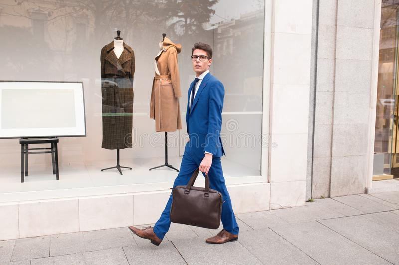 Attractive businessman walking down the street royalty free stock image