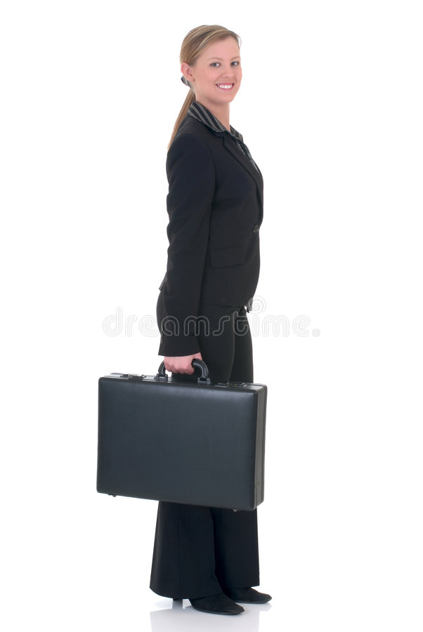 Attractive businesswoman. Attractive smiling successful young businesswoman with briefcase. studio shot royalty free stock photo