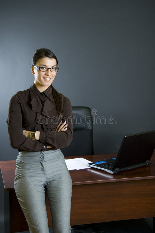 Download Attractive Businesswoman Against Office Desk Stock Image - Image of book, gesturing: 7633807