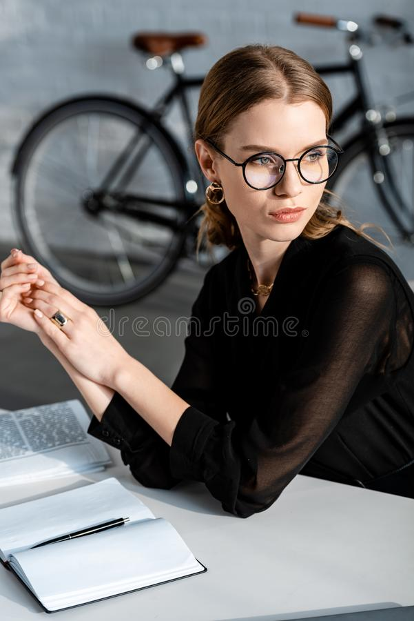 Attractive businesswoman in black clothes. Touching hands royalty free stock photos