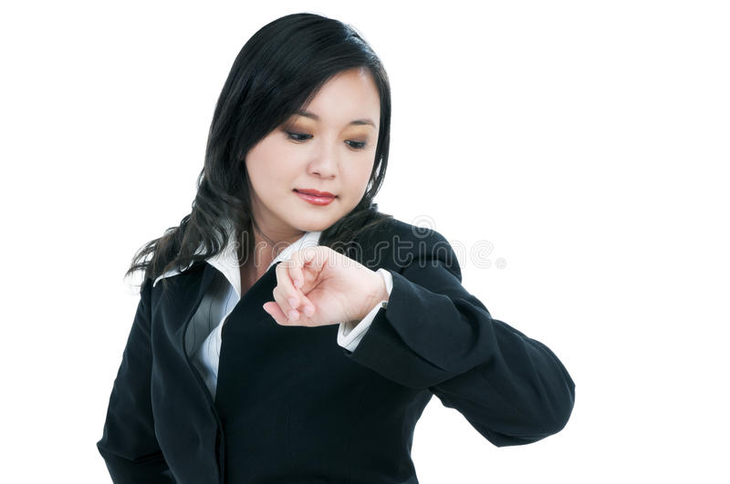 Attractive businesswoman checking time royalty free stock images