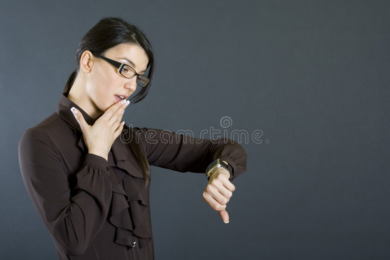 Attractive businesswoman checking time worried royalty free stock photos