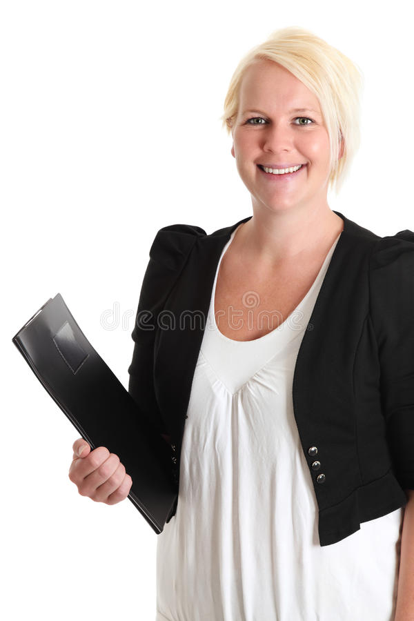 Attractive businesswoman with clipboard. An attractive young businesswoman in her 30s standing wearing a white shirt and suit. White background stock photo