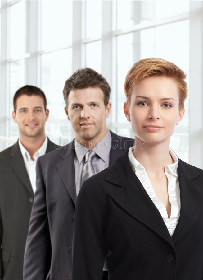 Attractive businesswoman and colleagues royalty free stock photo