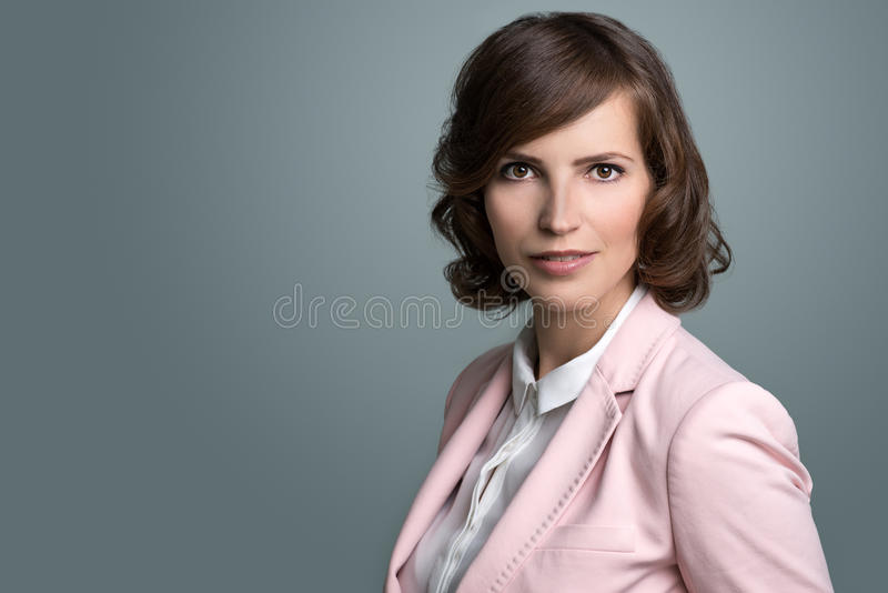 Attractive businesswoman with curly brown hair stock image