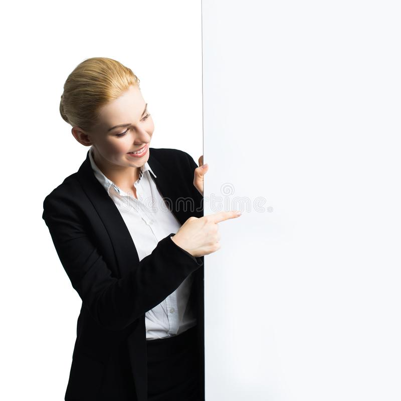 Attractive businesswoman with an empty canvas royalty free stock images
