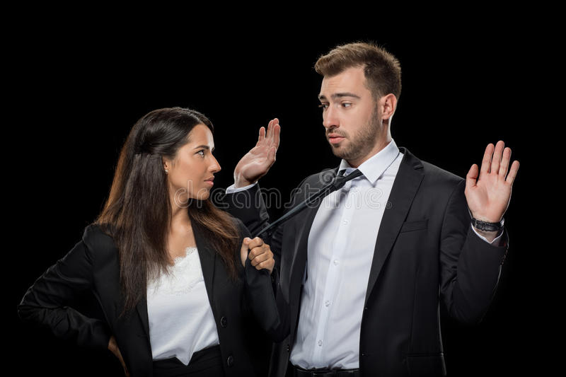 Attractive businesswoman flirting with her handsome colleague stock image