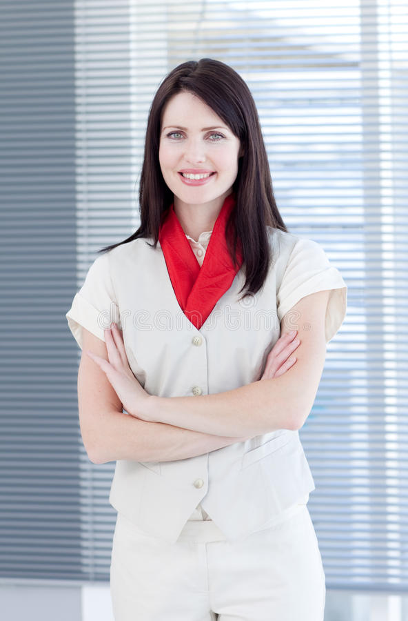 Attractive businesswoman with folded arms stock images