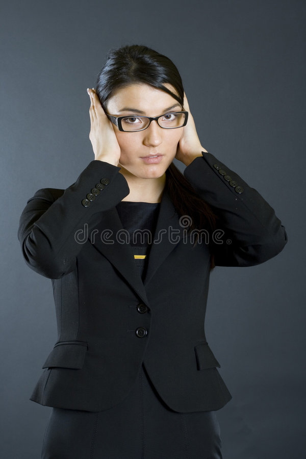 Attractive businesswoman hear no evil stock images