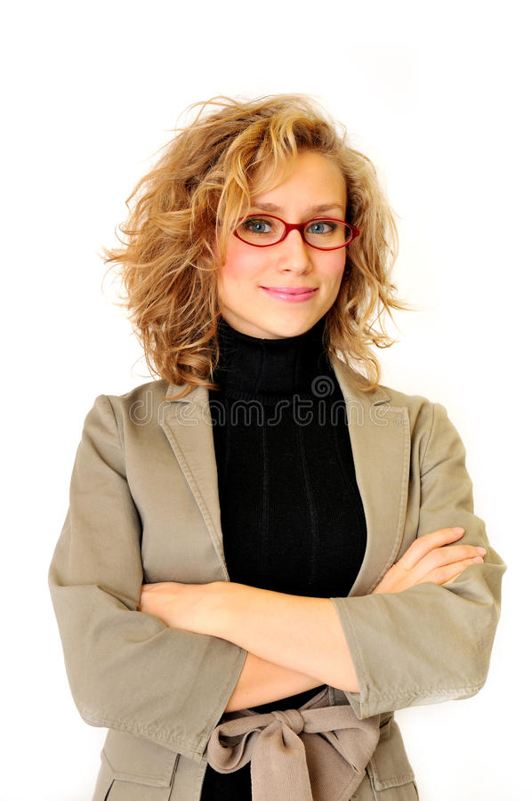 Attractive businesswoman. With her arms crossed stock photos