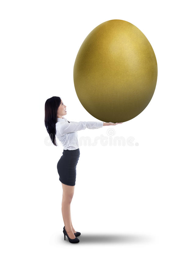 Download Attractive Businesswoman Holding Big Golden Egg - Stock Illustration - Image: 32305457