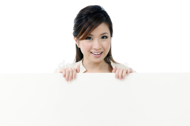 Attractive Businesswoman Holding Blank Billboard Royalty Free Stock Image