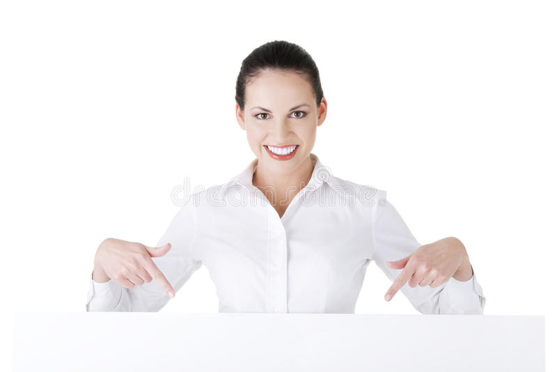 Attractive businesswoman holding blank board. royalty free stock photo