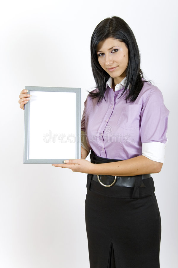 Attractive businesswoman holding a blank frame stock photography