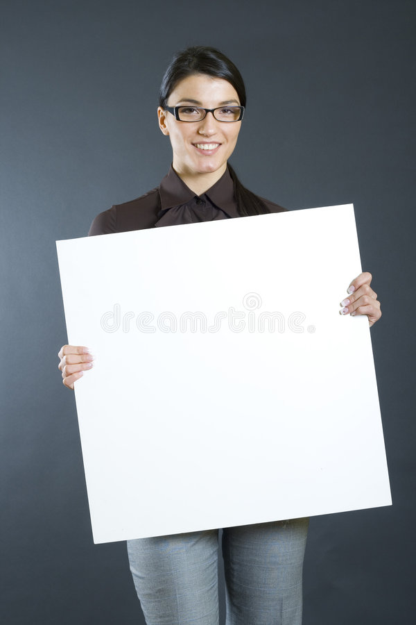 Attractive businesswoman holding a board stock photography