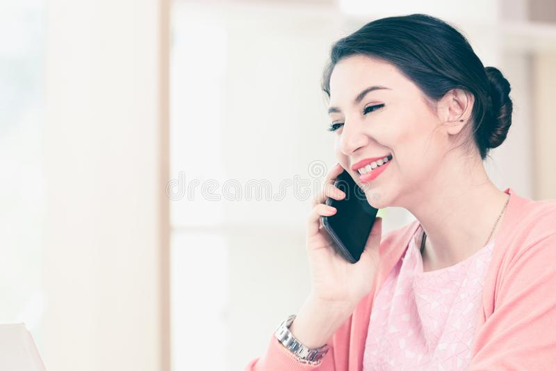 Attractive businesswoman holding phone stock photos