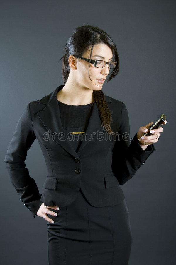Attractive businesswoman with mobile phone royalty free stock photo