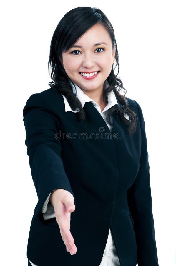 Attractive businesswoman offering handshake royalty free stock photo