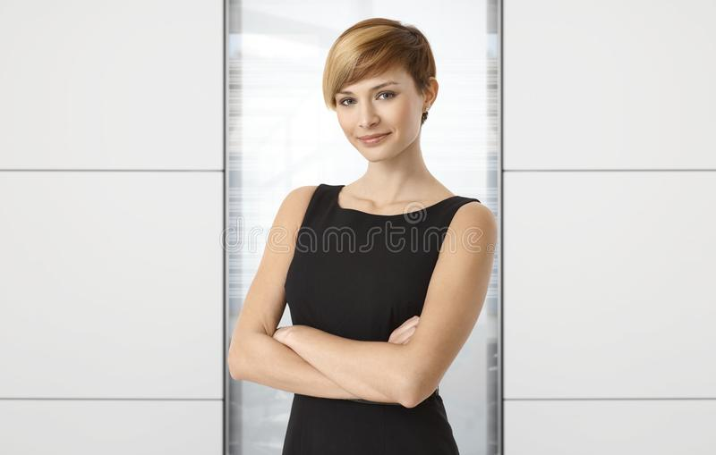 Attractive businesswoman at office. Copyspace on both sides stock photography