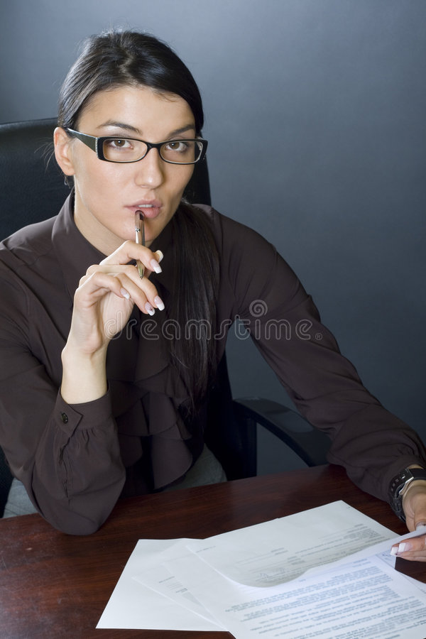 Download Attractive Businesswoman With Papers And Pen Stock Image - Image: 7634083