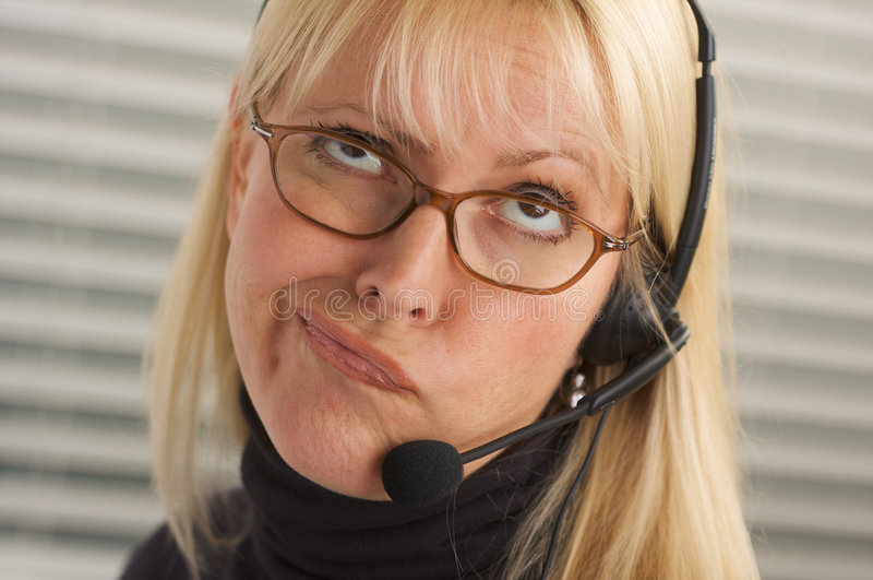 Attractive Businesswoman with Phone Headset stock photography