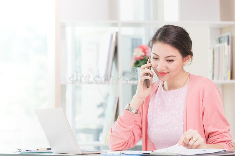 Attractive businesswoman sitting working stock images