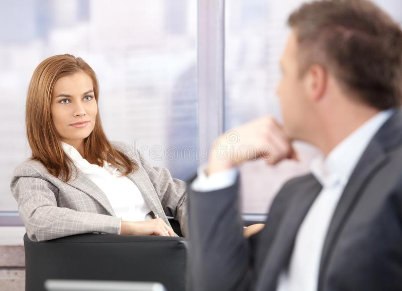 Attractive Businesswoman Smiling At Businessman Stock Images