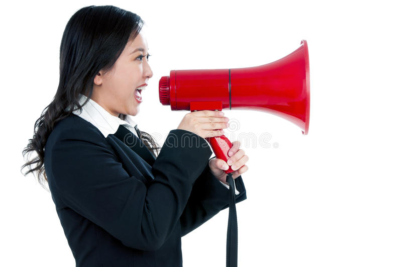 Attractive businesswoman using megaphone royalty free stock photography