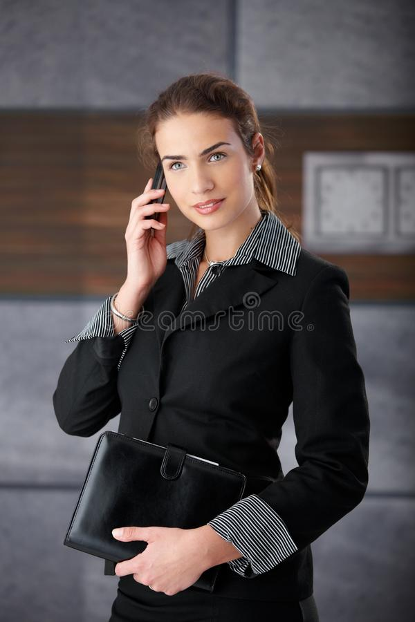 Download Attractive Businesswoman Using Mobile Royalty Free Stock Photo - Image: 17626405