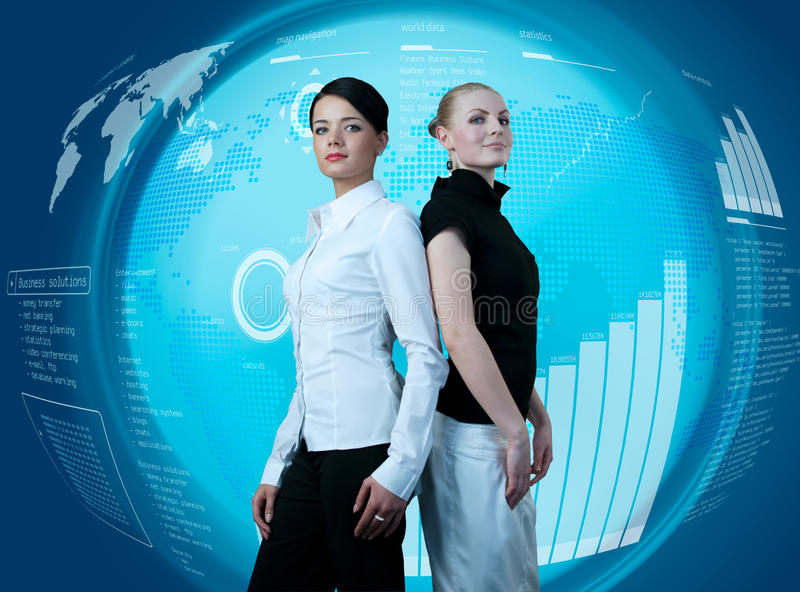 Attractive businesswomen in futuristic interface stock images