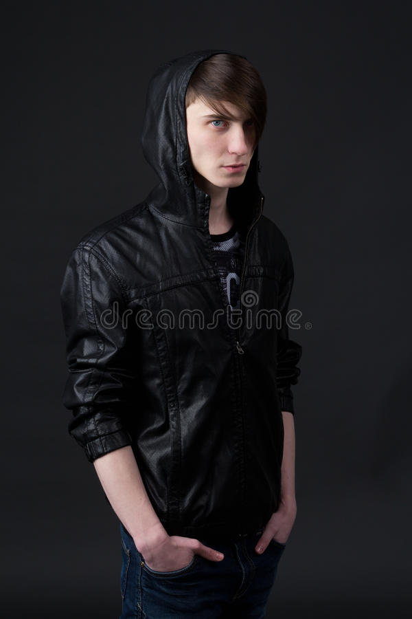 Attractive caucasian guy wearing a leather jacket royalty free stock image