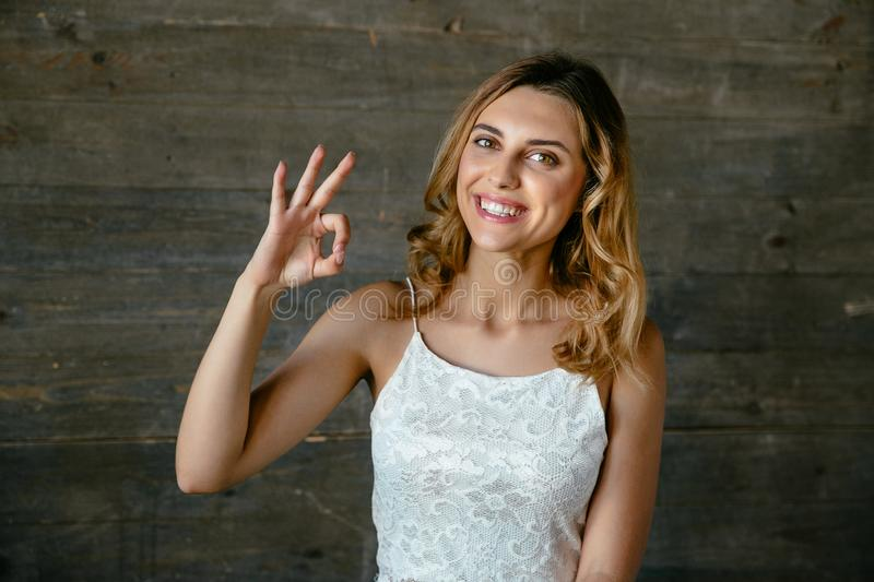 Beautiful woman showing okay sign stock photos