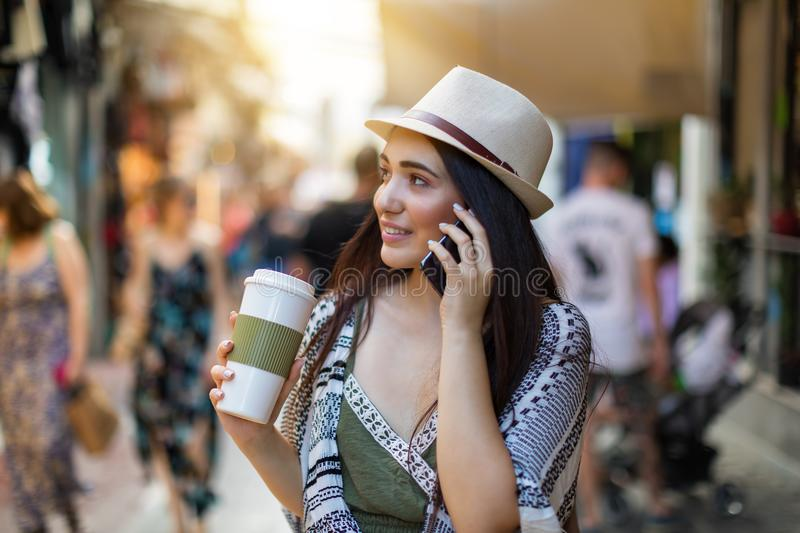 Attractive city hipster woman walking in the street stock photo
