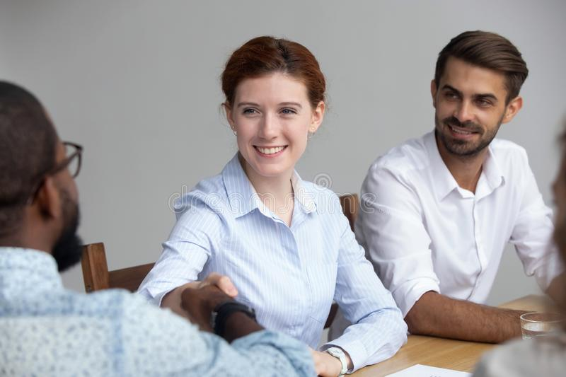 Partners greeting each other starting business meeting stock photography