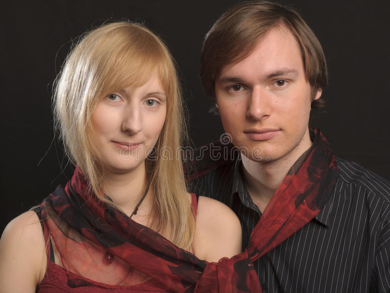 Attractive Couple. Against a Black Background stock image