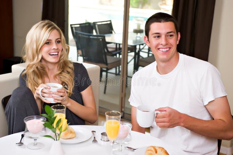 Attractive couple eats breakfast
