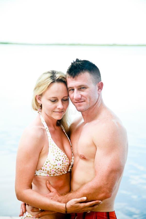 Attractive Couple Enjoying the Beach stock photos