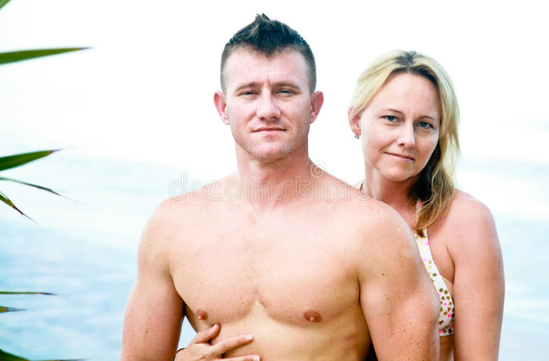 Attractive Couple Enjoying the Beach royalty free stock image