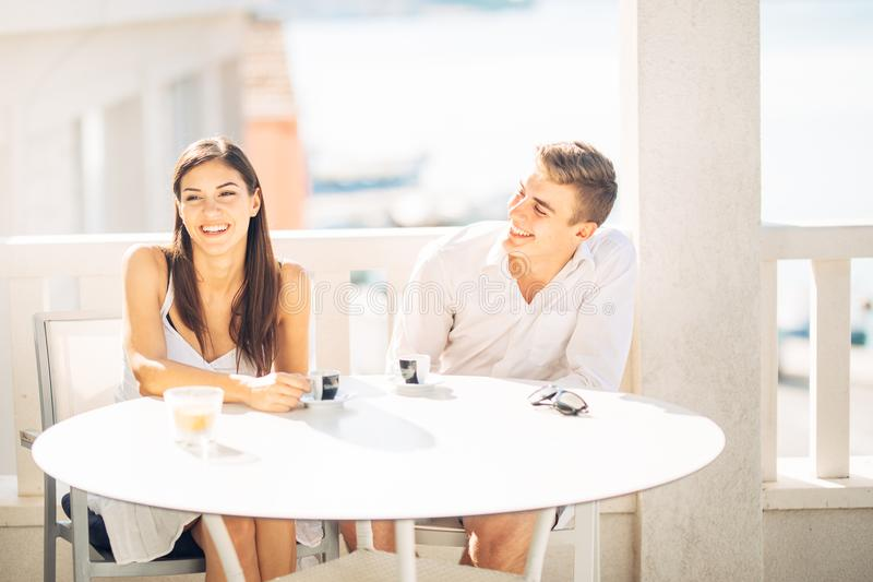 Attractive couple having first date.Blind date.Coffee with a friend.Smiling happy people having a coffee,dating. Getting to know each other.First romantic date royalty free stock photos