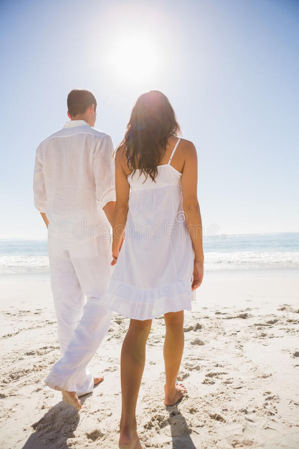 Download Attractive Couple Holding Hands And Walking To The Water Stock Image - Image: 33084067
