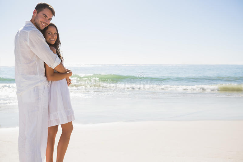 Attractive Couple Hugging And Looking At Camera Stock Images