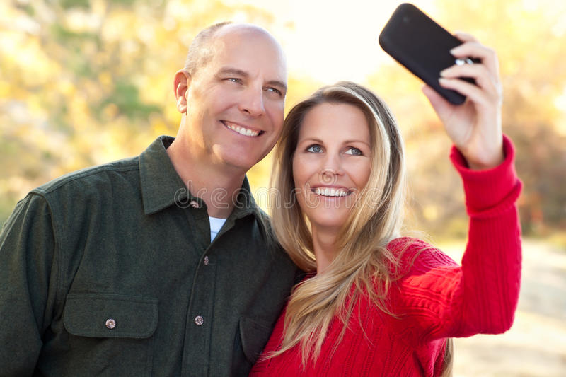 Download Attractive Couple Pose For A Self Portrait Stock Photo - Image of country, camera: 19188366